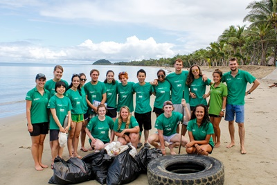Projects Abroad Shark Conservation volunteers pose for a group shot after a successful beach cleanup.
