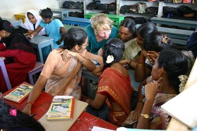 A volunteer helps female students at school