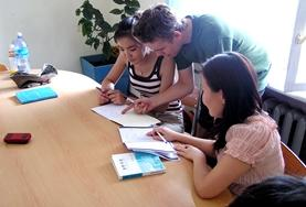 Volunteers work together on their Tamazight language course work at their placement