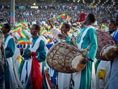 Local Ethiopians play the drums at a celebratory gathering