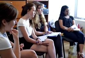 Romanian language course students listen intently during a lesson in Romania