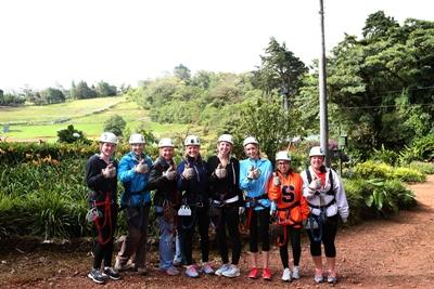 Volunteers prepare for zip-lining, while on an excursion to Poas Volcano