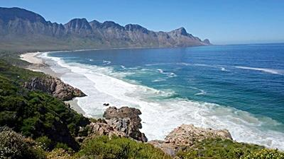 One of the many beautiful beaches in Cape Town, surrounded by the mountains