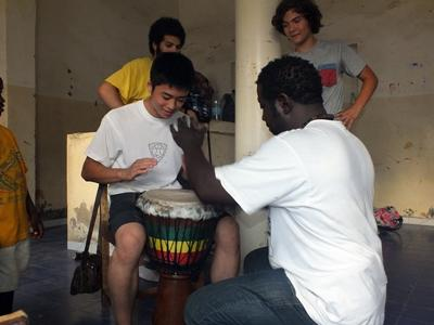 A volunteer learns to drum in Senegal