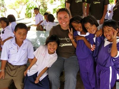 Care volunteer with children in Thailand