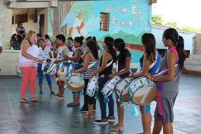 Projects Abroad volunteer teaches a group of children at the music project in Ecuador