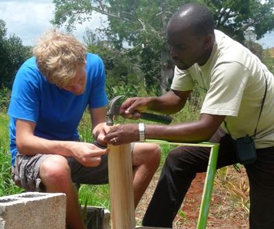 Volunteer in Jamaica constructs bookshelves with local staff