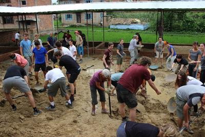 Projects Abroad Building volunteers work to dig the foundations for a new school in Kathmandu, Nepal