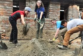 Building volunteers introduce children to their new school in Nepal