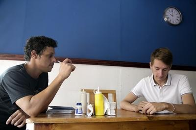 Volunteer discusses business plans with local restaurant owner