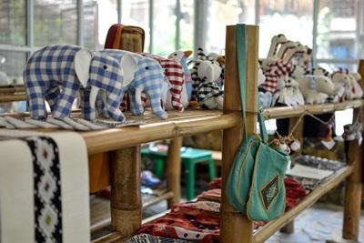 Raw silk and cotton handmade products displayed in the shop where Projects Abroad Business volunteers work