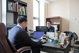 Two Business interns work at their desks at their placement in China.