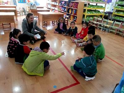 A volunteer on the Care placement plays a game with the children in China