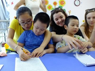 Volunteers working with children in a care placement in China,Asia