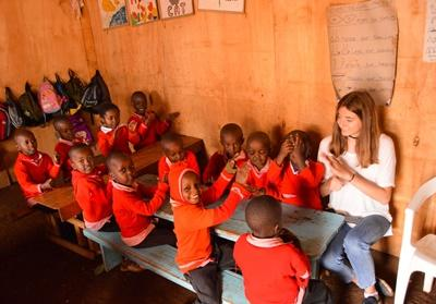 A Projects Abroad Care volunteer plays with children at a school in Nanyuki, Kenya