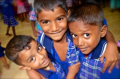 Three children from a Projects Abroad Care placement in Sri Lanka pose for the camera
