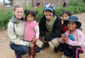 Volunteers pose with children at a Care Placement in Bolivia