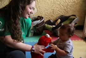 A volunteer plays with a child at a Care Project placement in Costa Rica