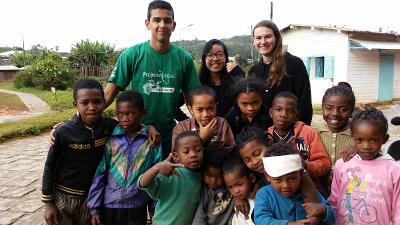 Group photo of Projects Abroad Madagascar Care volunteers and local children