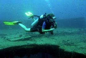 A Marine Conservation volunteer scuba dives on a placement