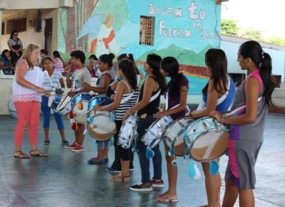 A Projects Abroad volunteer on the creative arts project trains a marching band at a high school in San Cristobal