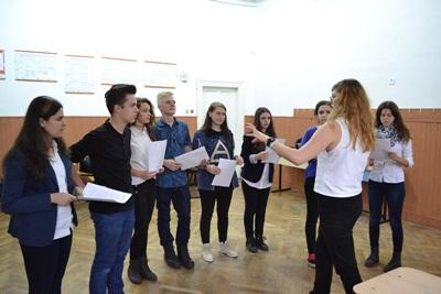 A group of teenagers listen to a volunteer drama teacher in Romania, Eastern Europe