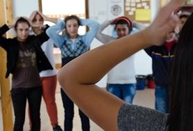 A volunteer Dance instructor teacher choreography to students at a placement in Romania
