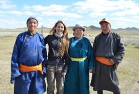 A volunteer spends time with her nomad host family during a cultural immersion project in Mongolia.