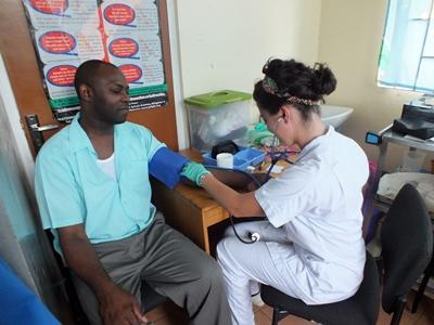 Medical volunteer takes a patient's blood pressure