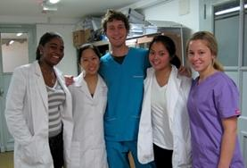 A volunteer poses with doctors at a placement in Argentina