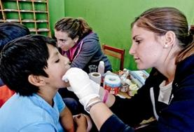 A Medicine Elective volunteer inspects a patient on a placement in Peru