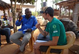 An International Development volunteer discusses sustainable business plans with the staff member of a local NGO in Togo.