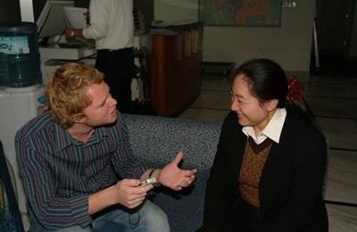 Journalism volunteer in China interviews a local lady