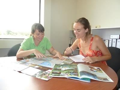A Journalism volunteer conducts research for an article