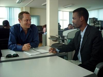 A volunteer interviews a local man in Ethiopia
