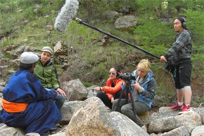 A Projects Abroad Journalism volunteer conducting an interview outdoors