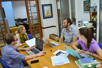 Canadian Projects Abroad Law & Human Rights volunteers chat with interns in an office in Rabat, Morocco