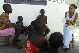 A Human Rights volunteer speaks to local people in Togo about their rights during an awareness campaign.