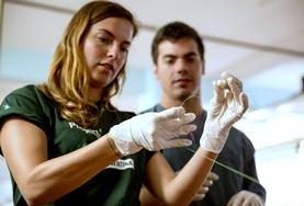 Volunteers demonstrate basic medical prodcedures during an outreach in Argentina