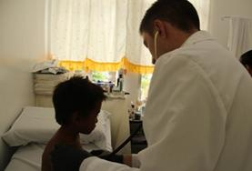 A Medicine volunteer inspects a patient on a placement in the Philippines