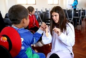 A Nursing volunteer interacts with a child on a placement in Peru