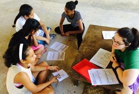 A volunteer discussion nutrition with children at a placement in Bolivia