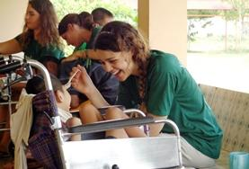 A volunteer on a Physiotherapy Project in Bolivia interacts with a child