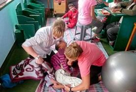 Physiotherapy volunteers work with a patient during a session in Nepal