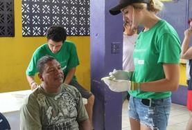 A group of Public Health volunteers runs a healthcare awareness campaign to combat obesity in a community in Belize.