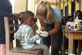 A Public Health volunteer inspects a patient while on a oublic outreach at a placement in Madagascar