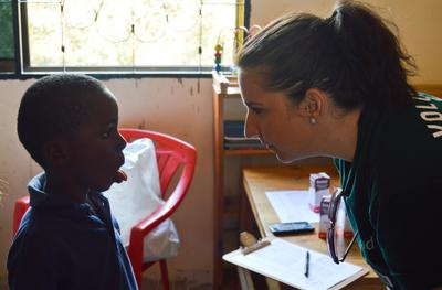 A Projects Abroad Speech Therapy volunteer works with a young boy
