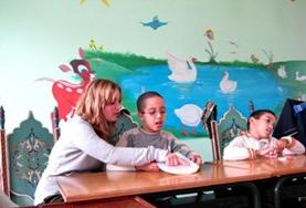A volunteer works with Speech Therapy patient's at her placement in Morocco