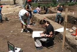 A professional Archaeologist reords details about a dig site at our volunteer placement in Transylvania, Romania.