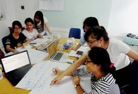 A qualified Social Worker gives a workshop to Social Work volunteers at a childcare placement in Vietnam.